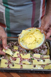 Finition avec des lamelles de fromage