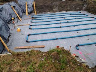 Système de drainage du sol par tuyaux enterrés